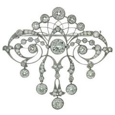 Magnificent Edwardian Diamond Platinum Filigree Brooch | From a unique collection of vintage brooches at https://www.1stdibs.com/jewelry/brooches/brooches/