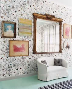 A decorative, oversized mirror fills in empty wall space. | http://domino.com