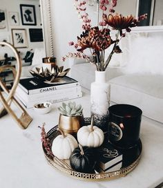Chic black and white vignette with painted black and white mini pumpkins on a small round tray