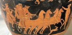 Figure 4: The Abduction of Persephone by Hades on a red-figure vase with Hermes with his caduceus leading the way.