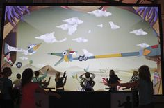 An interactive installation where visitors can use their arms to puppeteer the projected creatures. Really clever and visually beautiful installation, appealing to both adults and children. Created by Design I/O.