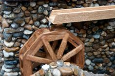 The WaterLily Mill  Go back in time with this wonderful, hand-built, Watermill  Designed by Roger J. Davies and exclusive to 'Enchanted Cottages' The Watermill is built from pebbles and riverstone...