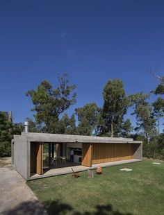 Architecture Discover Slatted timber doors unfold along house in Uruguay by Masa Arquitectos Modern Small House Design, Casas Containers, Timber Door, Concrete Houses, Cement House, Box Houses, Container House Design, Home Fashion, Future House