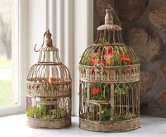 I love the idea of putting colorful flowers in a bird cage!