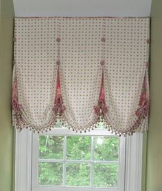 This flat balloon shade is made so custom looking by its use of buttons, great trim & the hint of a contrast fabric peeking out.