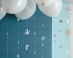 snowflake garland hanging from balloons