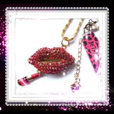 Betsy Johnson red crystal lips with lipstick. Betsy Johnson red crystal lips with a gold chain attached lipstick. The lips are entirely covered in red crystals very eye carching. The lipstick is very authentic looking. Betsey Johnson Jewelry
