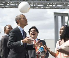 """President Barack Obama and his soccer connection:     President Obama plays with a """"soccket"""" ball, a soccer ball that captures the energy during game play to charge LEDs and small batteries, alongside Tanzanian President Jakaya Kikwete on July 2, 2013, during a demonstration at the Ubungo Plaza Symbion Power Plant in Dar Es Salaam, Tanzania."""