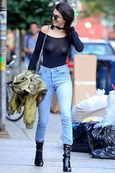 Kendall Jener in a see-through black long-sleeve top, high waisted blue jeans and patent leather booties while out in NYC.