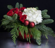 Fresh evergreens and red ball ornaments . add fresh white hydrangea and red roses. Christmas Flower Decorations, Christmas Floral Designs, Christmas Flowers, Noel Christmas, Christmas Centerpieces, Floral Centerpieces, Christmas Wreaths, Winter Floral Arrangements, Christmas Flower Arrangements