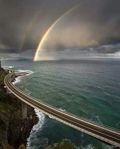Bridge is nice but I love the rainbow shot in background.Sea Cliff Bridge in South Coast, Australia. Places To Travel, Places To See, Beautiful World, Beautiful Places, Beautiful Gorgeous, Beautiful Pictures, Places Around The World, Around The Worlds, Foto Nature