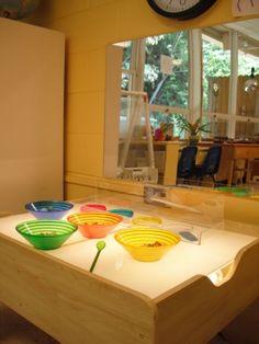 Highland Plaza United Methodist Preschool-coloured transparent bowls on the light table.