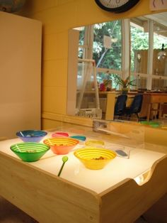 Highland Plaza United Methodist Preschool-coloured transparent bowls on the light table.