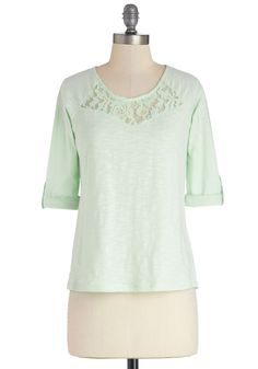 Telling Stories Top, #ModCloth-- Your friends sit on either side of you, hanging on to every word of the story you're telling as a flickering candle illuminates your mint top. The plot twists you create amaze your pals, as does the sheer lace neckline and pretty pastel hue of your long-sleeved top. Worn with distressed skinnies and a sunshine-yellow cardigan, this charming piece proves that you could write a book on casual-chic style!