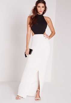 Up your monochrome game this season and opt for this maxi dress. Maxi dresses give off those sophisticated, elegant vibes, so you can guarantee all eyes are on you. With a sexy backless design, figure-flattering fit and a colour block contr...