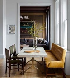 Mismatched dining furniture adds a great eclectic feel and this small vintage couch is the perfect alternative to different chairs. Original comment: #dining