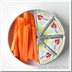 This is not only cute but very easy and tasty! Just grab a wheel of Laughing Cow cheese wedges, take half out, and stick carrots, celery, or crackers in there. Pop to lid back on and you're ready to rock and roll! Healthy and very clever. Best part? No containers to clean up! My only problem is that I'd probably eat all the cheese before I even had a chance to cut up the carrots. Oops!