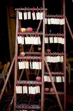 Harvest themed escort cards using an orchard ladder, wood veneer tags and apples. Jen Kroll Photography. A Day in May Events.