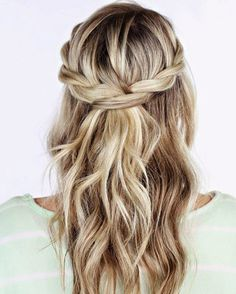 loose braids to the back like a summer look.