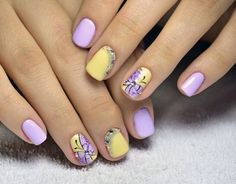 Purple and yellow themed butterfly nail art design. The gradient designs coupled with embellishments help accentuate the nails and the butterfly design altogether.