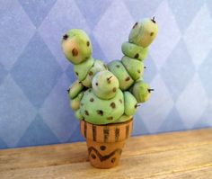 Magical Mimbulus Mimbletonia Plant in dollhouse miniature from the world of Harry Potter. $64.95, via Etsy.