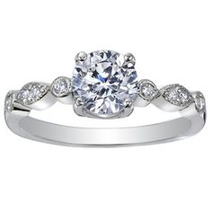 Platinum Tiara Diamond Ring    The Tiara setting offers a harmonious balance of complementary round and marquise shapes with miniature detailing added for grand effect. A delicate band offers a lovely contrast to larger gems, but can accentuate smaller gems just as well.