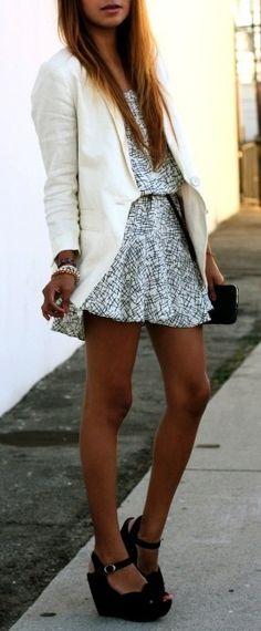 White Blazer over printed dress.