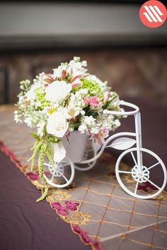 Mixed flower centerpiece in pastel shades, with base in the shape of a bicycle. Flower Centerpieces, Wedding Centerpieces, Wedding Decorations, Diy Wedding, Wedding Flowers, Dream Wedding, Deco Floral, Floral Design, Wedding Planer