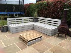 Placing the reclaimed pallet patio furniture in the patio is the perfect idea for those who don't want anything common in their home. The individuals who are style-conscious can create patio furniture at home, making a bench with the table shown here is awesome.