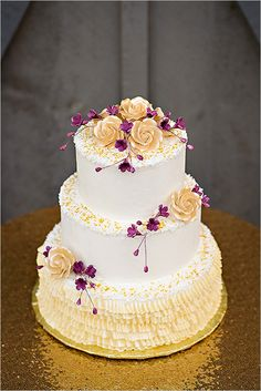 Purple and Gold wedding cake by Lueken's Village Foods