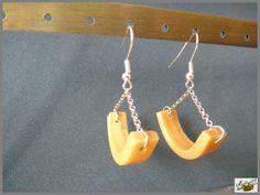 Boucles d'oreilles dorées par Maïlys07.