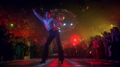 John Travolta disco dancing in an iconic scene from Saturday Night Fever which takes place in Brooklyn. John Travolta, Boogie Nights, Mode Disco, Disco Disco, Disco Ball, 1970s Disco, Disco Party, Disco Floor, 70s Party