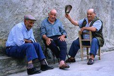 Tuili, Sardinia    Elderly Sardinian men chatting in the village of Tuili.