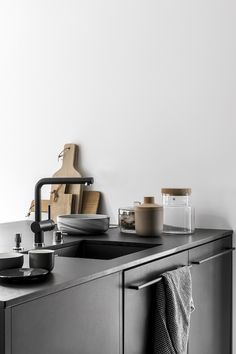 vosgesparis: A beautiful all black kitchen and minimal dining room with lots of cork