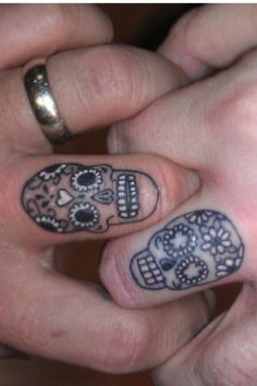 What does wedding ring tattoo mean? We have wedding ring tattoo ideas, designs, symbolism and we explain the meaning behind the tattoo. Wedding Band Tattoo, Tattoo Band, Skull Wedding Ring, Wedding Rings, Skeleton Tattoos, Sugar Skull Tattoos, Sugar Skulls, Trendy Tattoos, Small Tattoos