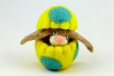 The cutest light brown Easter bunny in a yellow Easter egg with turquoise dots. Ooak Waldorf toy.  The egg can be used for bunnys nest or as an