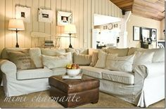 Painted wood paneling, light furniture and wood ceiling