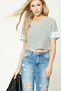 A burnout knit crop top featuring a scoop neckline and two distressed athletic stripes on the sleeves.