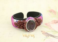 Hand painted leather bracelet in warm purple and bright colours with nice and warm Sodalite stone.  Hand Made in Europe by blessed Scandinavian Leather artists, exclusively for Valfrea. #leather #jewellery #sodalite #handmade #bracelet #bangle #unique #fashion #unisex #leatherjewelry #valfrea #oneofakind at valfrea.com.au