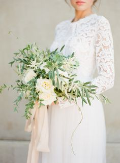 Organic olive branch + cream rose bouquet: Photography : Vasia Photography Read More on SMP: http://www.stylemepretty.com/2016/07/25/white-on-white-greek-wedding-inspiration/