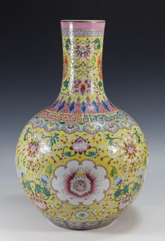 """19th C Chinese Famille Rose Flower Bottle Vase Yellow ground with flowers all over. neck decorated with five bats. mark on bottom Dimension: 16""""H x 11""""W"""