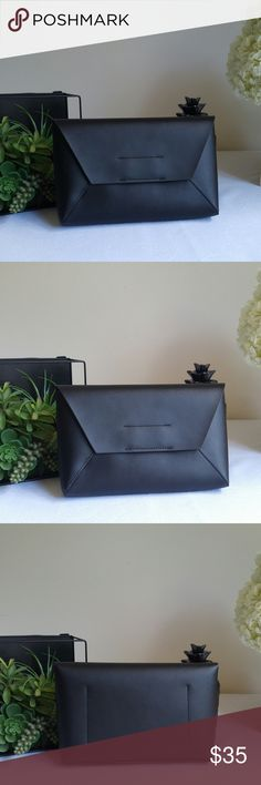 """✨J Crew black leather basic envelope clutch Basic black soft leather clutch with magnetic closure. One inner pocket.  See other listings for styling ideas.  6.5"""" H × 10.25"""" W × 1.75"""" D    ✨Condition is new with packaging- purchased online- never used    ✨✨Check out my other listings to get a bundle discount. Happy to answer any questions. ☺☺ J. Crew Bags Clutches & Wristlets"""