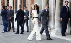 Stella McCartney - For the civil ceremony that took place on Monday, Alamuddin sported a custom Stella McCartney ensemble that brought to mind Bianca Jagger's iconic choice back in 1971—proving good taste never goes out of style. Palazzo pants and a propper topper gave the look a modern spin for the couple's first official steps as newlyweds.