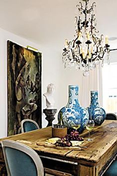New Orleans home of Shaun Smith. Love the farm house table paired with an elegant chandelier! TG