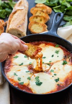 17 baked cheese appetizer recipes, like Baked Mozzarella and Marinara Dip, that are perfect for your next dinner party.