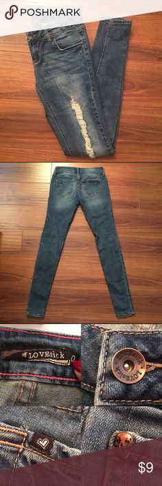 """Lovesick Distressed Jeans Light staining on the right shin (as seen on 1st and 4th picture). Also there is a minor stain on right pocket. Waist measures 13.5"""" laying flat. Approx measurements: Rise: 7"""", Inseam: 30"""", Leg opening: 9"""". Fair condition. Lovesick Jeans Skinny"""