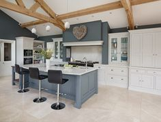 A spacious kitchen featuring statement blue island plays host to the latest cutting edge appliances from Sub-Zero, Wolf and Miele. Cosy Kitchen, Shaker Kitchen, Living Room Kitchen, Home Decor Kitchen, Interior Design Kitchen, Kitchen Furniture, New Kitchen, Kitchen Island, Barn Kitchen