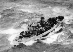 Canadian corvette HCMS Timmins in rough seas during patrol in the North Atlantic, 1941.
