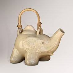 An elephant holds its trunk high on our Novica Cream Elephant Ceramic Teapot. Elephant Teapot, Coffee Bars In Kitchen, Cute Teapot, Cute Kitchen, Kitchen Stuff, Flying Elephant, Cream Tea, Tea Accessories, Decorative Accessories