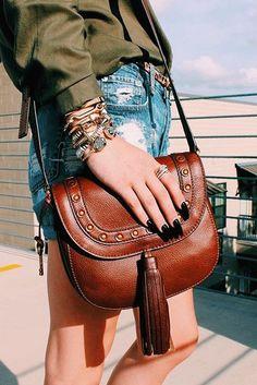 The perfect everyday crossbody handbag: the Emi tassel saddle bag. via @simply.mady